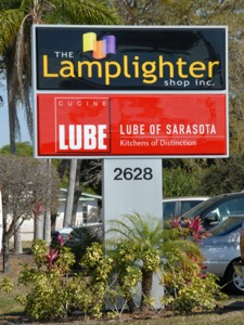Pylon sign for The Lamplighter Shop & Lube of Sarasota. To see more pylon & pole signs like this, CLICK HERE to view the pylon & pole sign section of our Portfolio page.